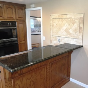 after photo of granite counter and backsplash