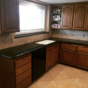 granite kitchen counter with backsplash