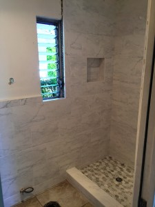 white carrara shower with marble mosaic tile