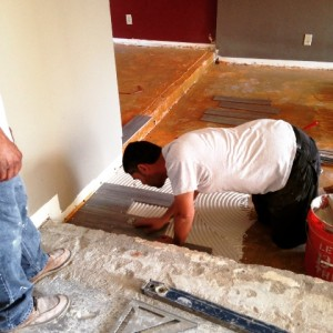 Install of porcelain tile in living room