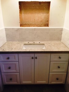 after photo of the vanity with granite counter and backsplash