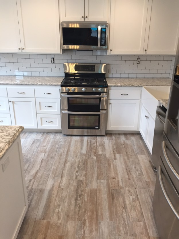 Porcelain wood tile t f i tile marble design for Hardwood floor tile kitchen