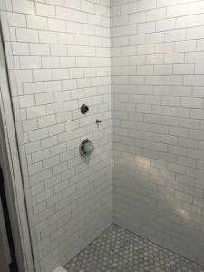 shower remodel with 3x6 glossy and carrara octagon mosaic